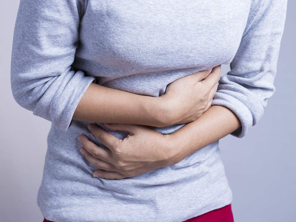 Woman with stomach problems