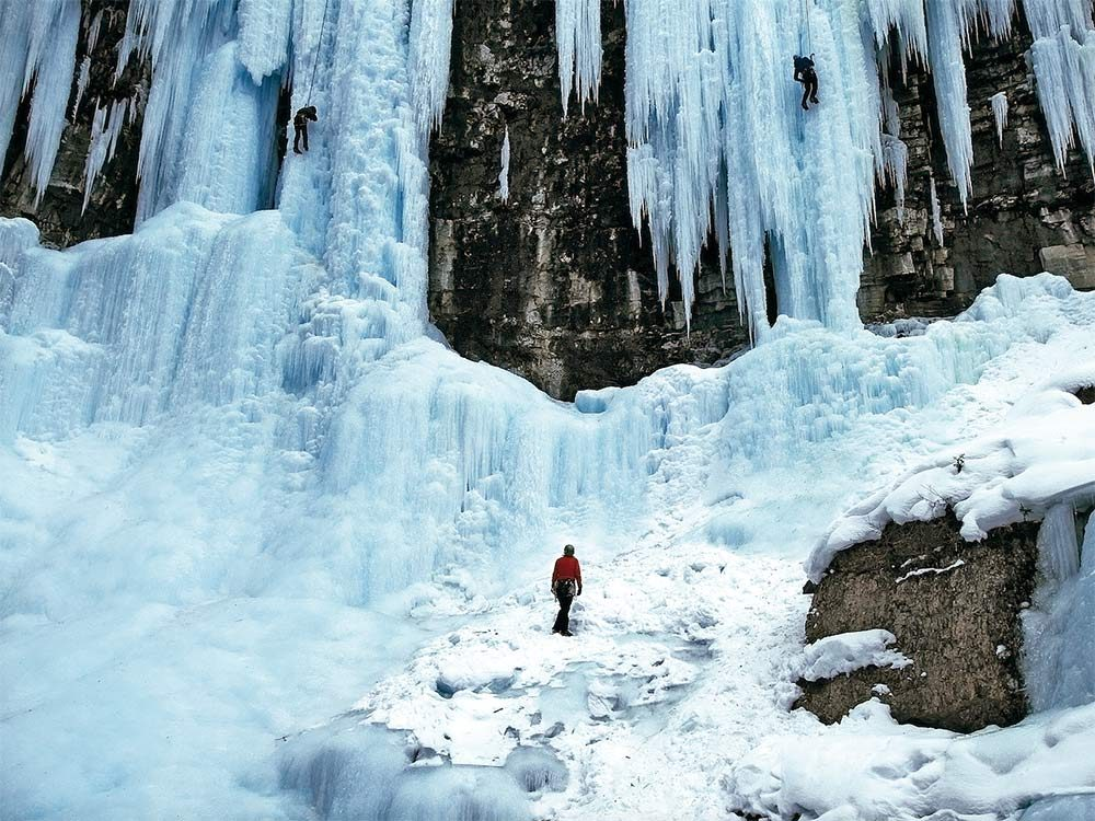 Ice climbers scaling a cliff face