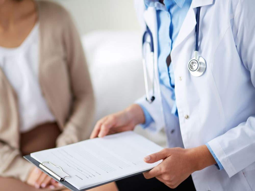 Doctor and patient discussing diabetes signs