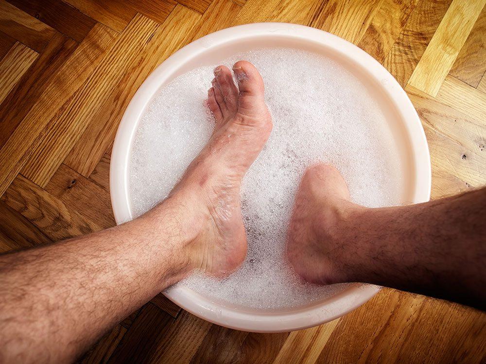 Feet soaking in a warm bath
