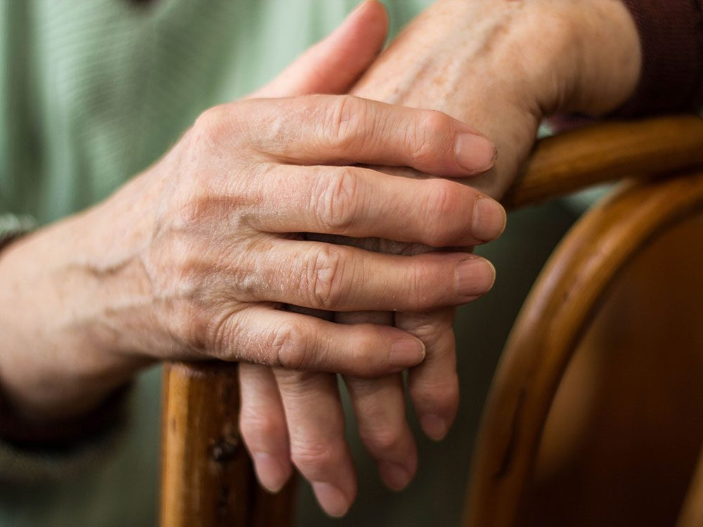 Close-up of elderly person's hands