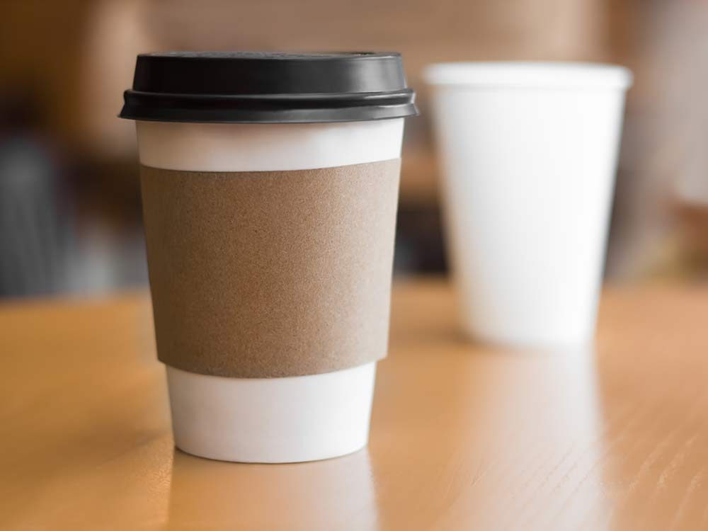Coffee cup with holder and lid