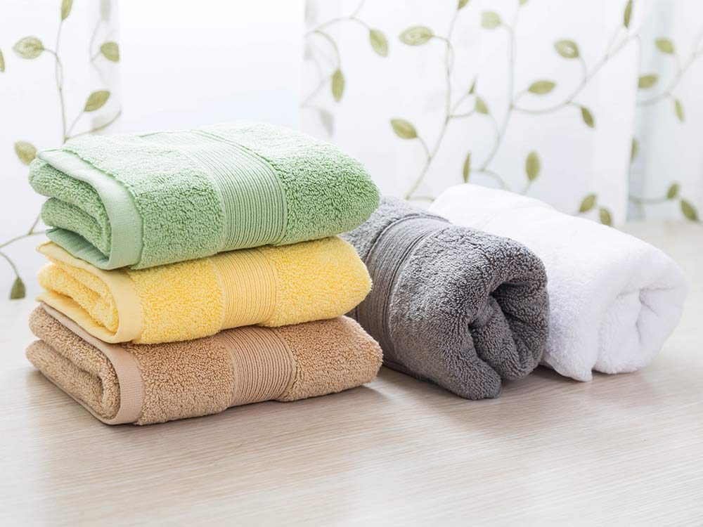 Towels and linens folded on table