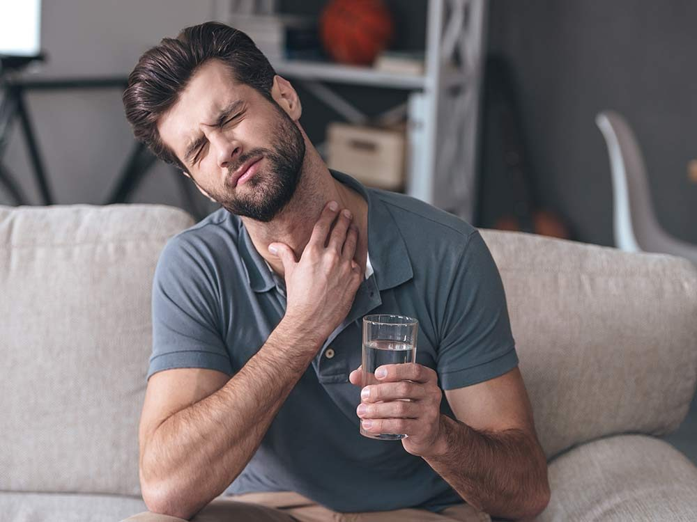 Man with pain in his throat