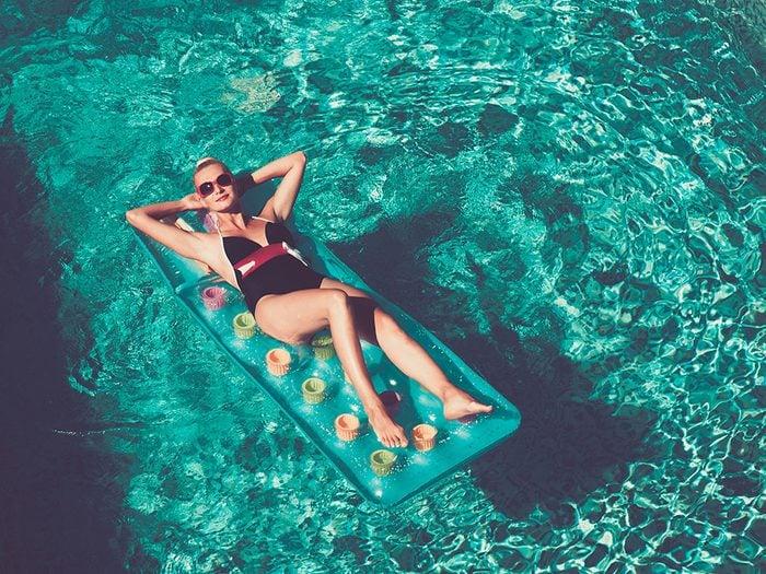 Blonde swimming in pool