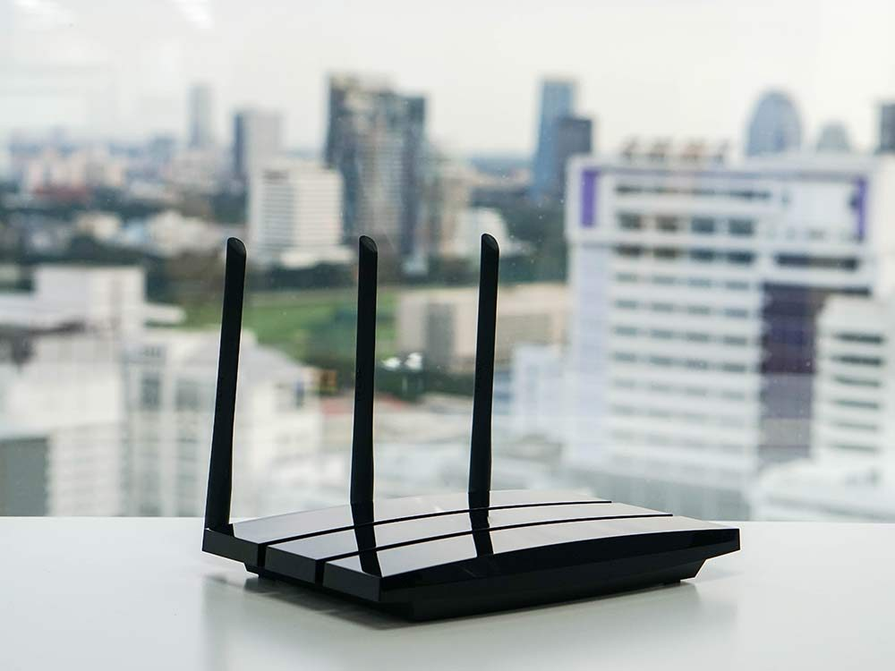 Wireless router on desk with a view of the city