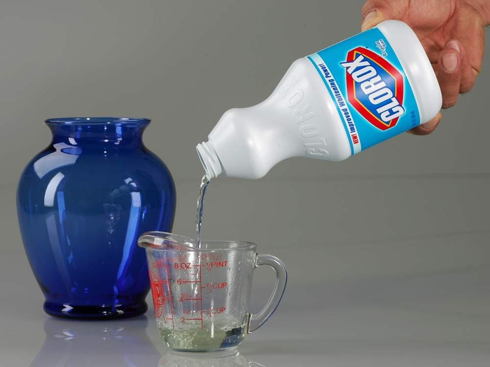 Clorox bleach being poured into measuring cup