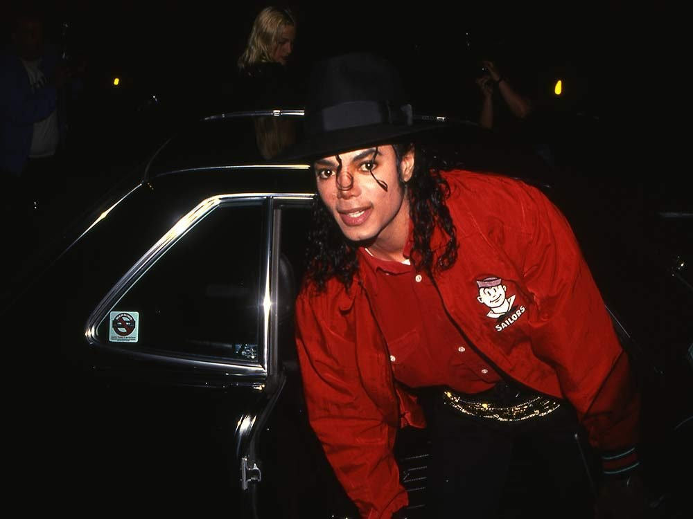 Michael Jackson exiting car in 1990