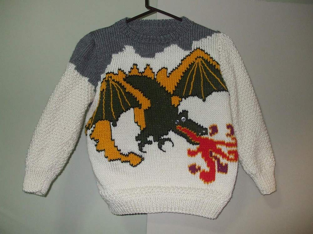 Knitted sweater with dragon design