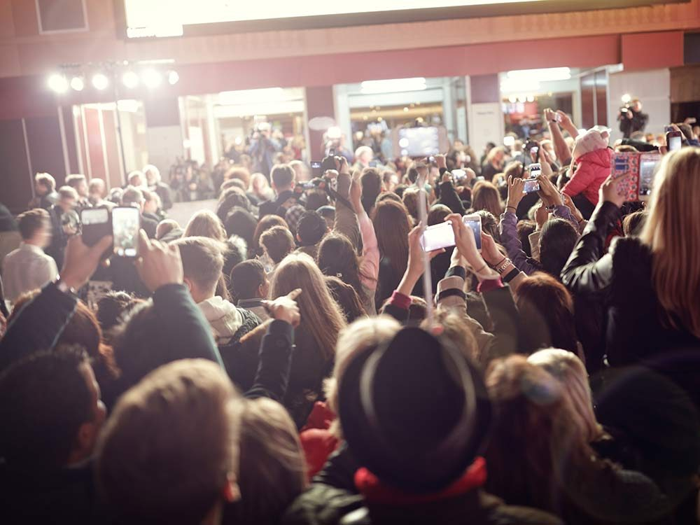 Paparazzi and fans at movie premiere