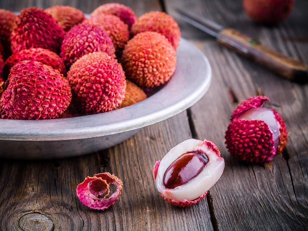 Red lychee fruit in bowl