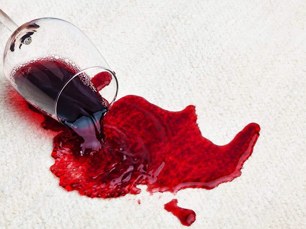 Red wine spill on white carpet