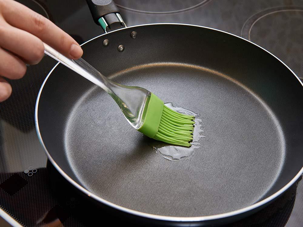 Canola oil brushed onto pan