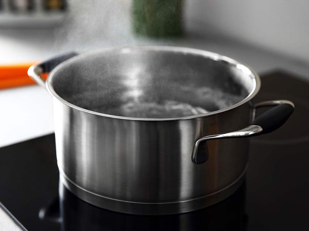 Boiling water in pan on stove