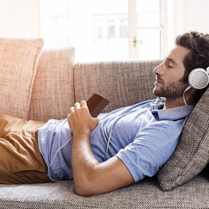Best songs to help you sleep - man listening to music sleeping on sofa