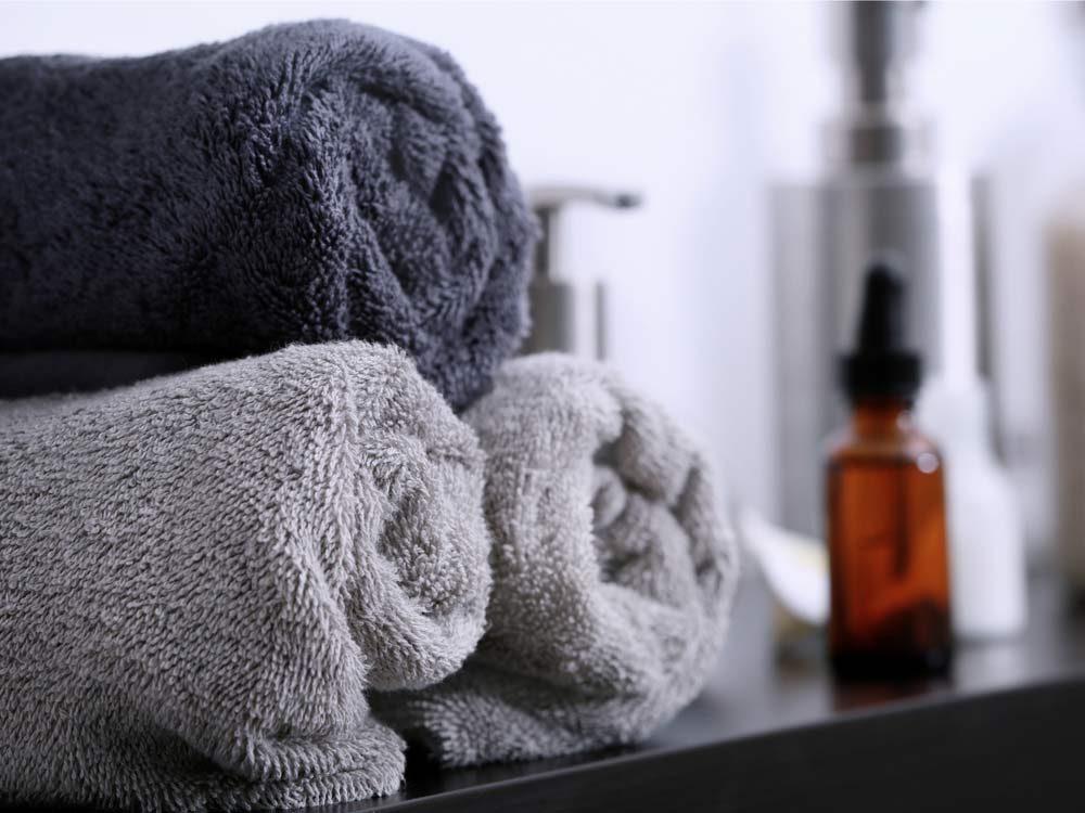 Dark towels folded on bathroom counter