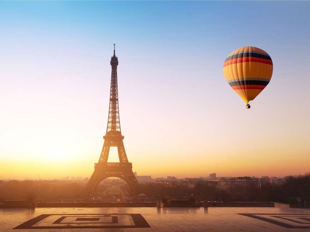 Hot air balloon flying near Eiffel Tower in Paris, France
