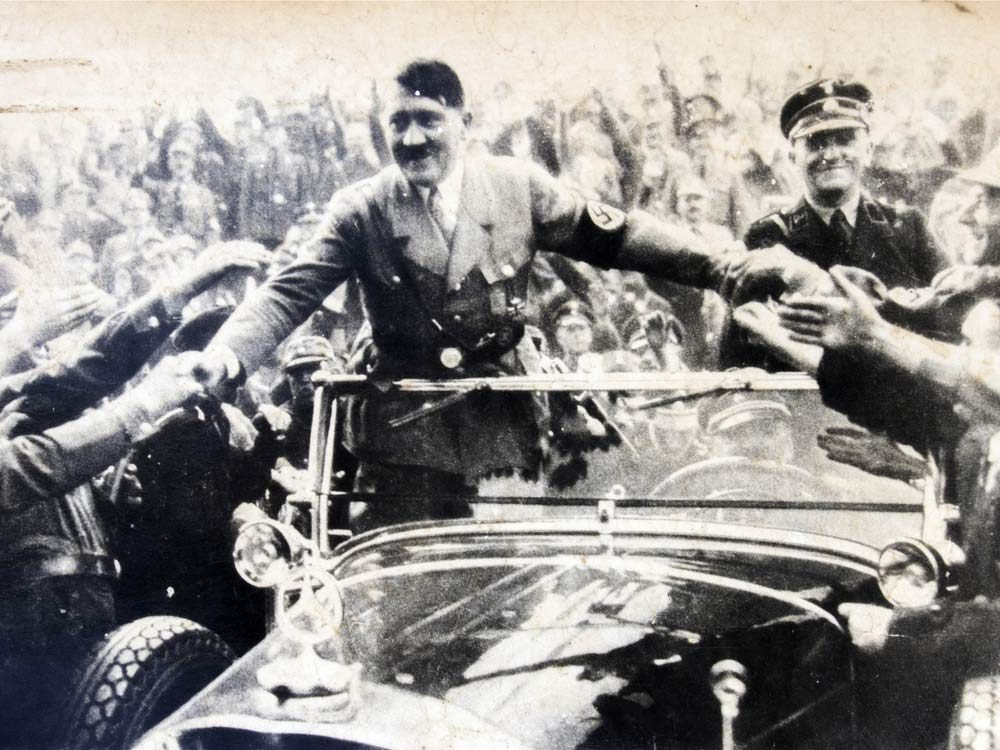 Adolf Hitler greeting his supporters