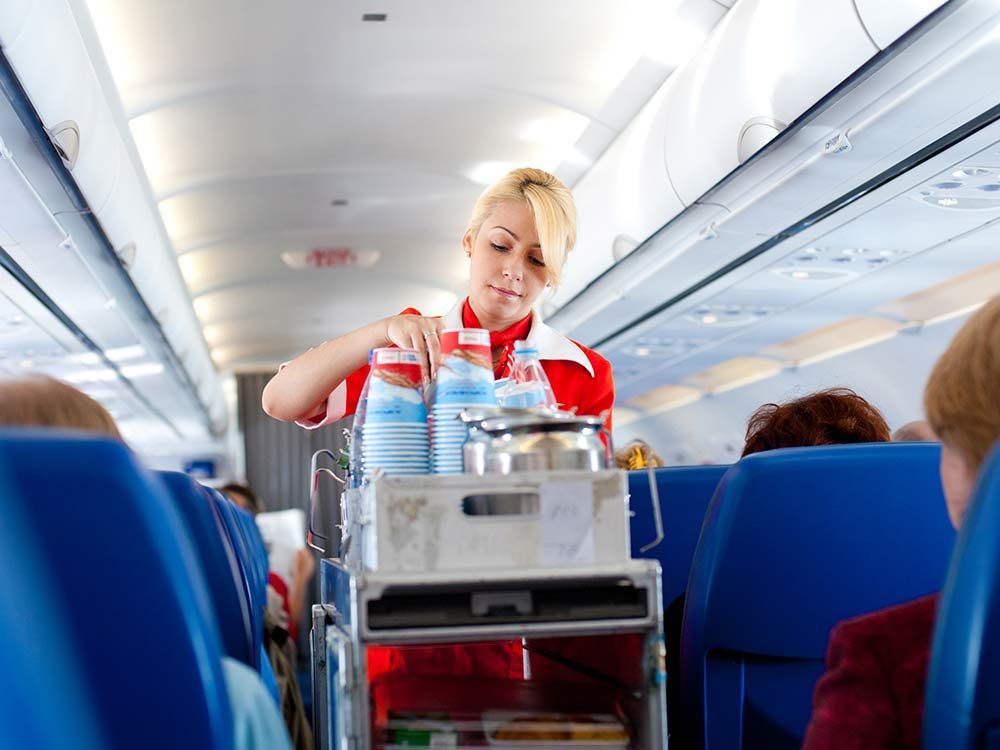 Flight attendant on airplane