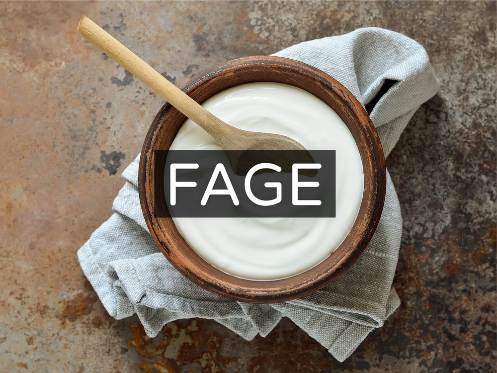 Greek yogurt in wooden bowl