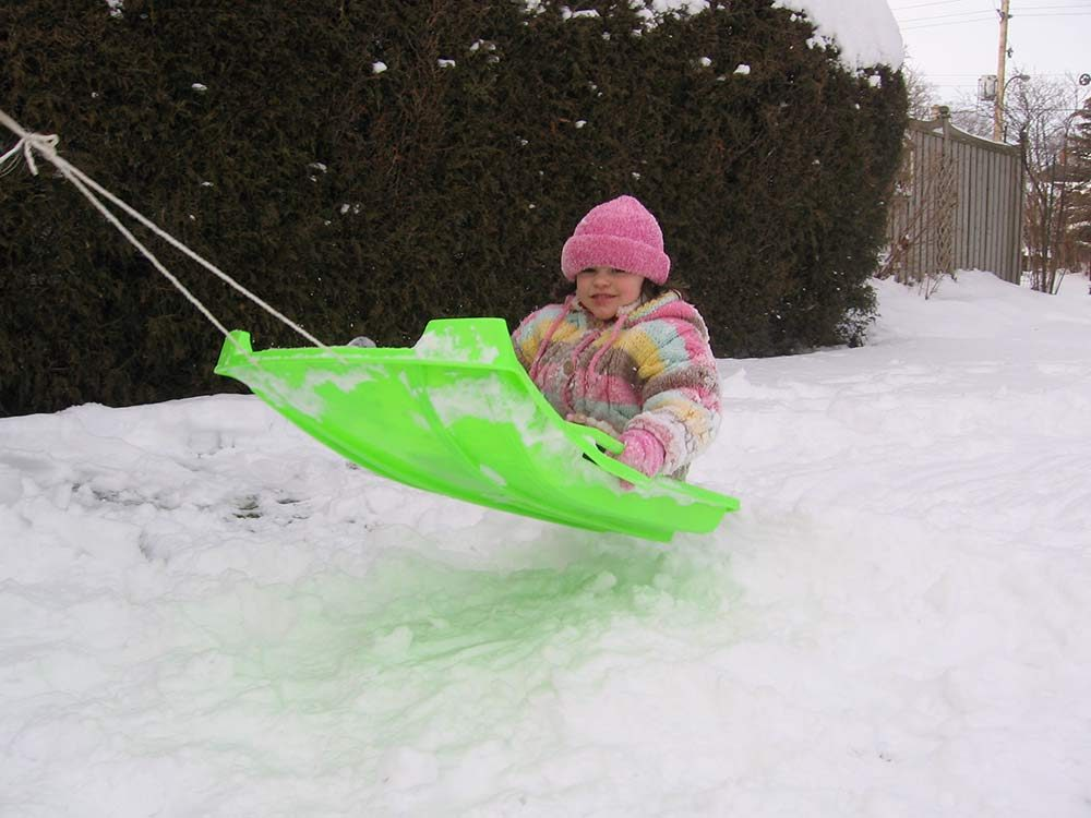 Young girl on sled