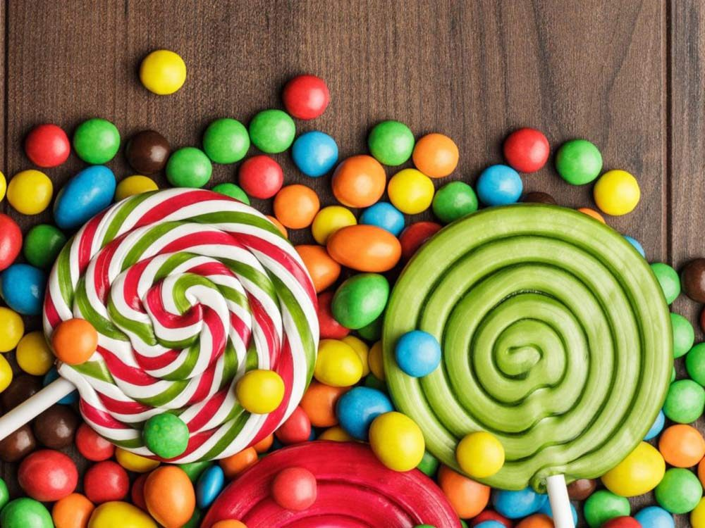 Two lollipops and assorted candies