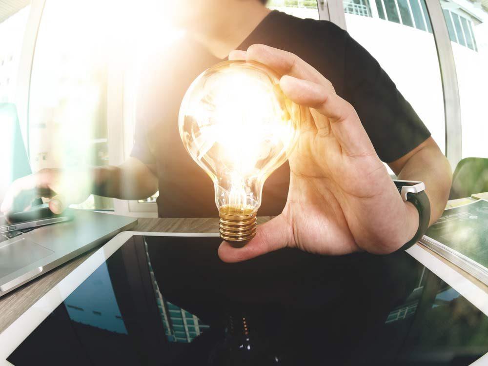 Young man holding lightbulb