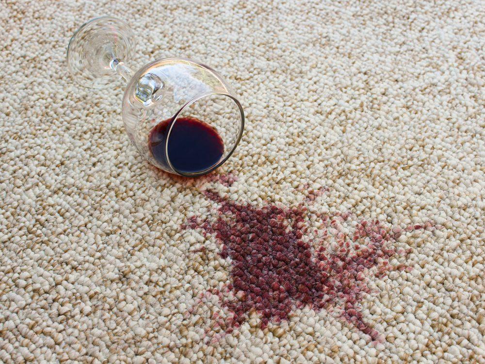Red wine spilled on white carpet