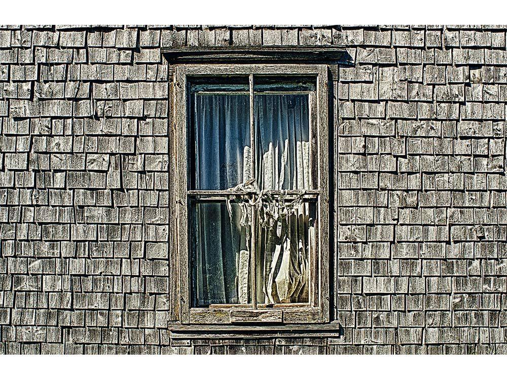 Bedroom window of abandoned home