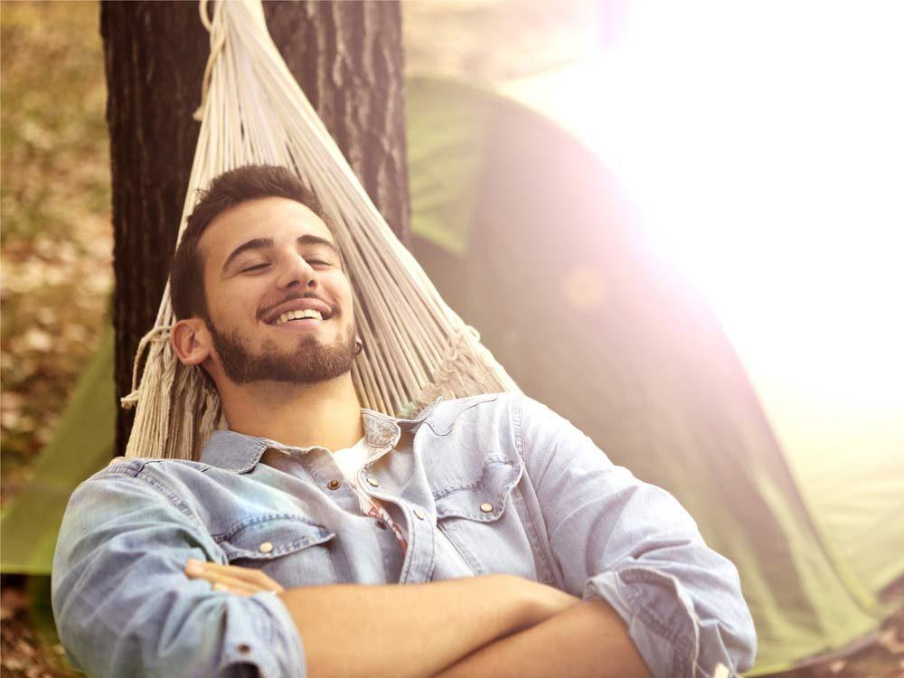 Happy man in hammock