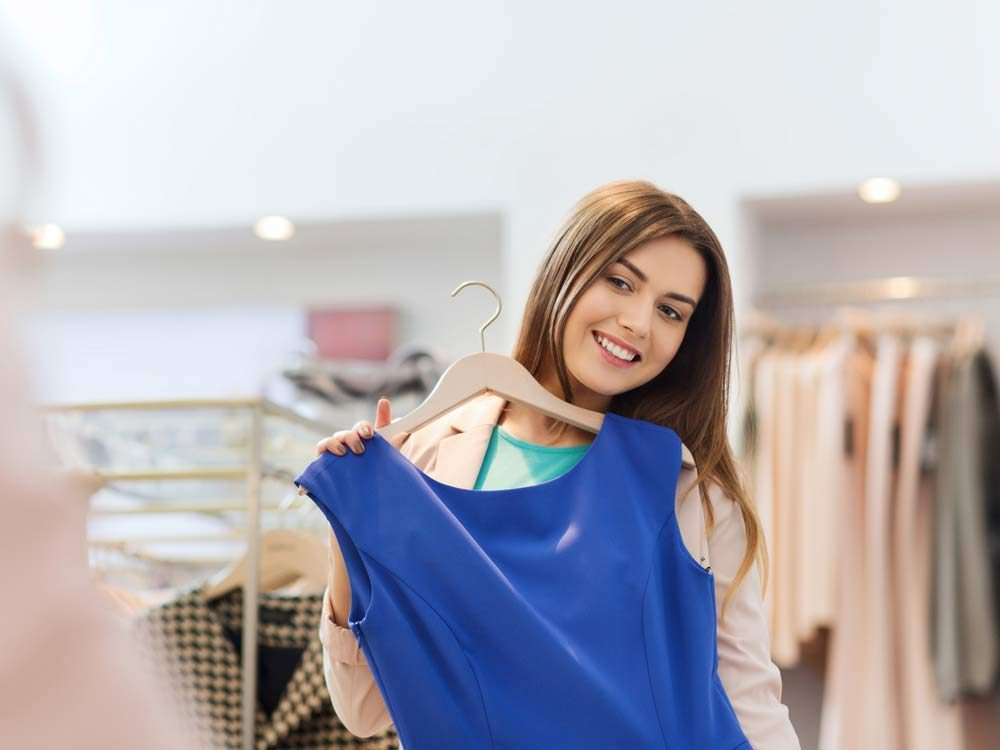 Woman trying on blouse