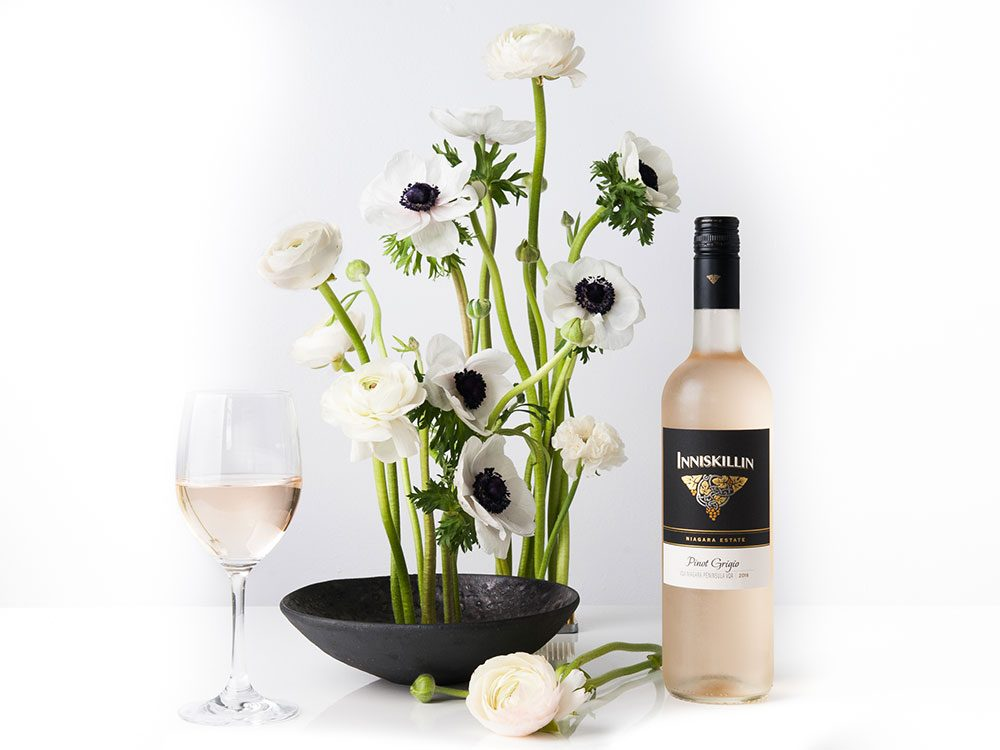 Inniskillin pinot grigio paired with flower arrangement