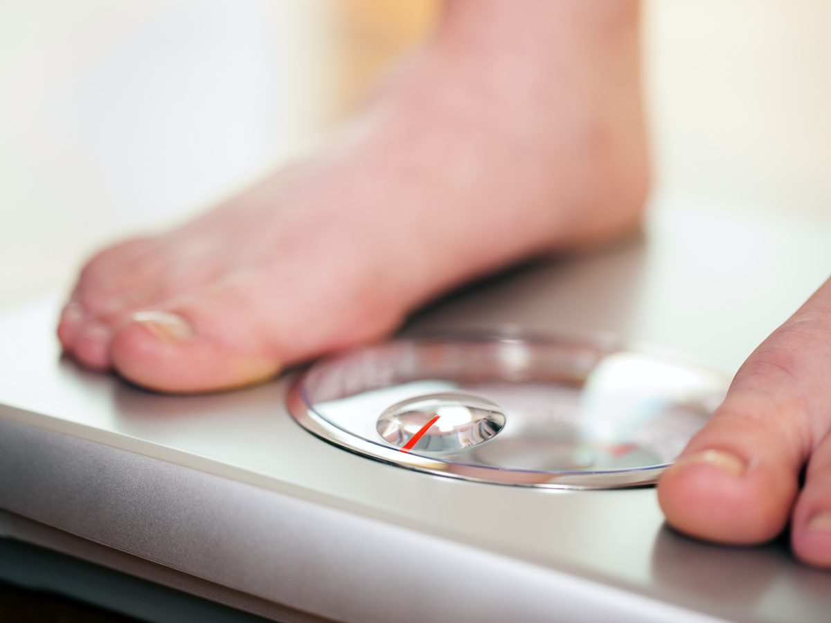 Close-up of feet on weight scale