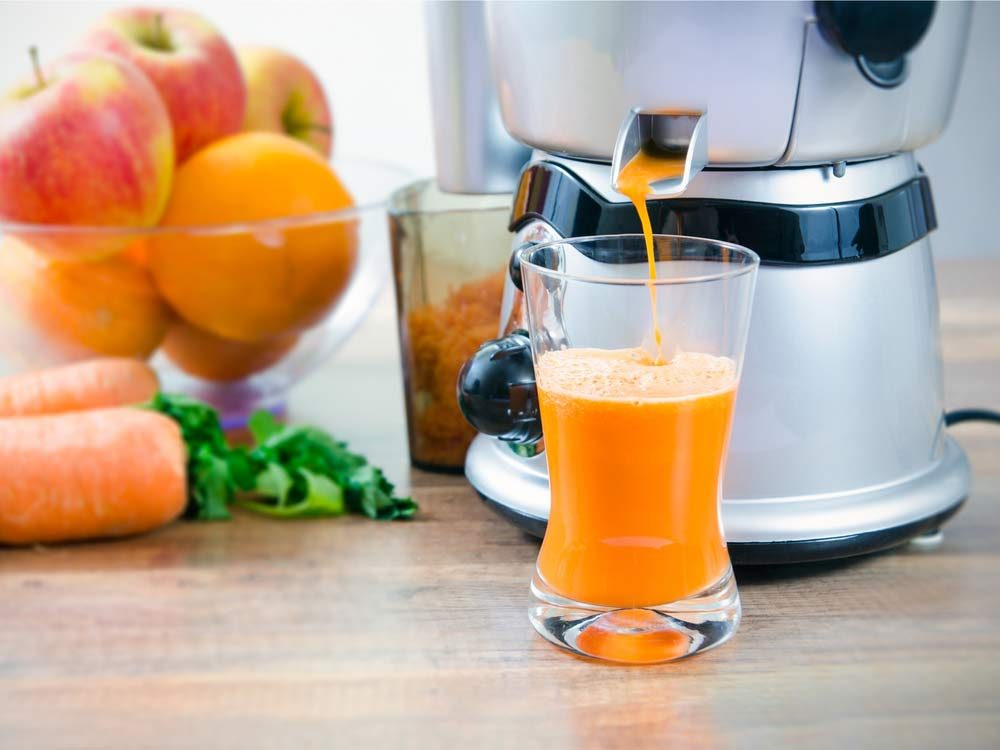 Carrot juice in juicer