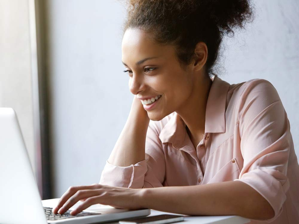 Woman on laptop at desk