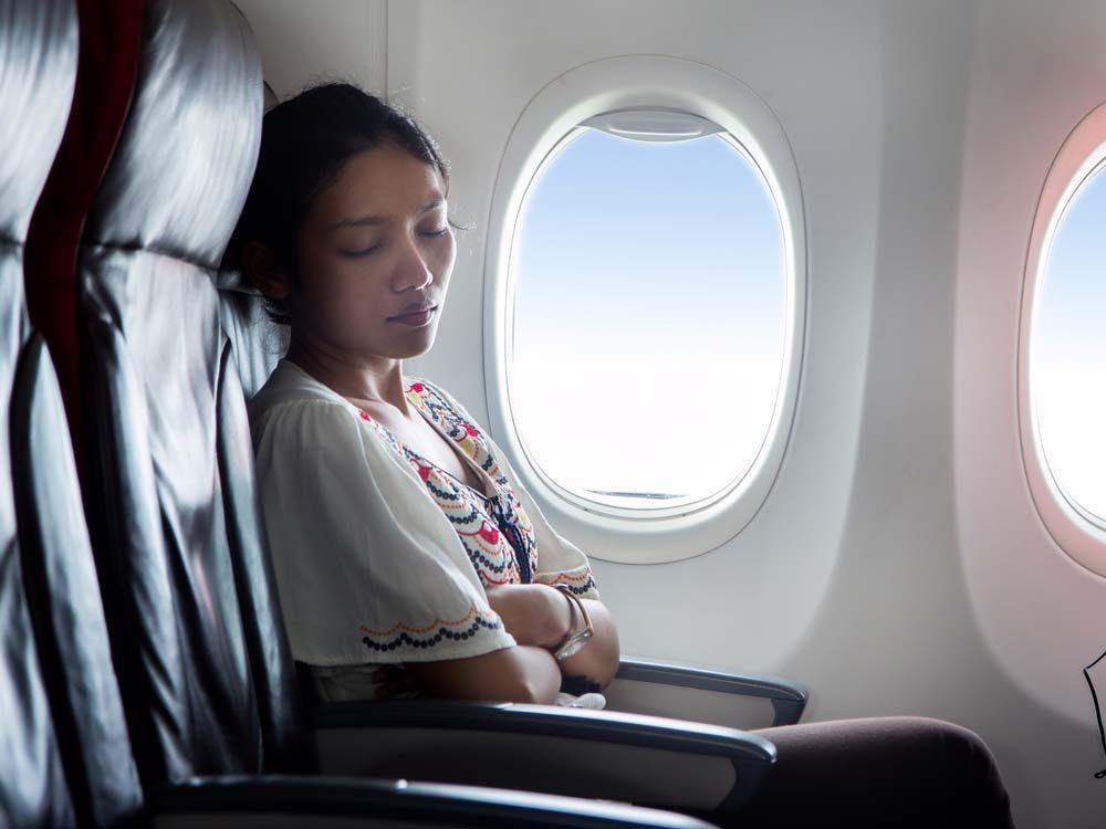 Woman sleeping on airplane