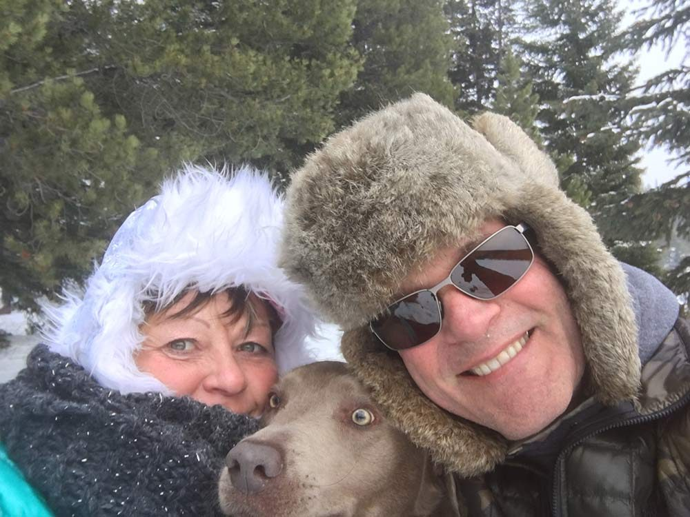 Couple selfie with pet dog