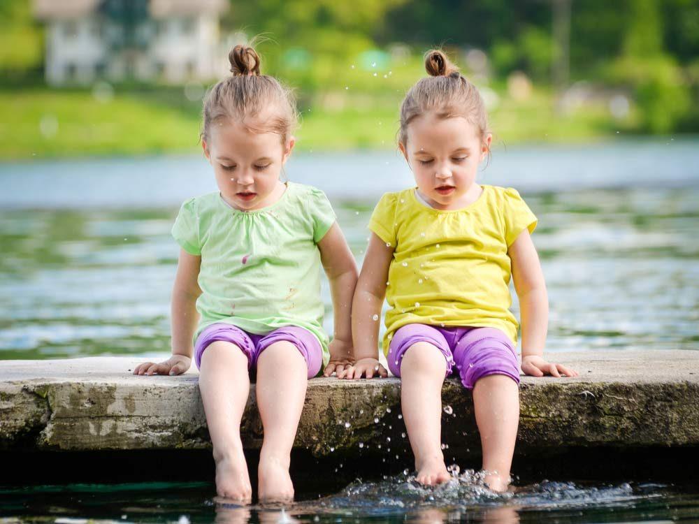 Twin little girls playing