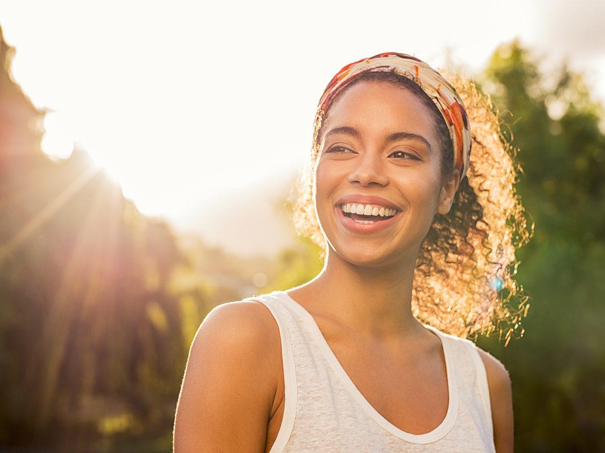 Mineral sunscreen benefits - woman enjoying safe sun