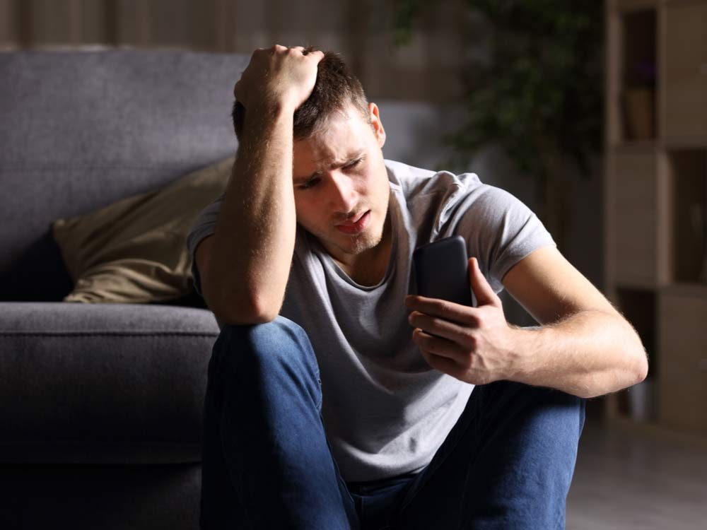 Man crying in apartment