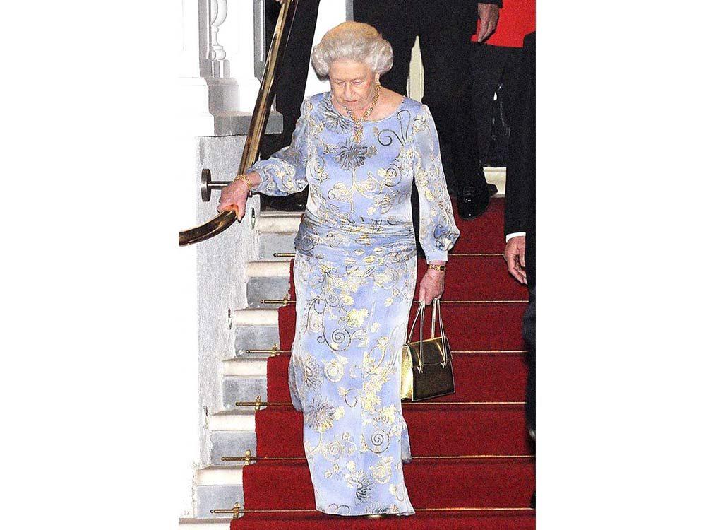 Queen Elizabeth II walking down the stairs