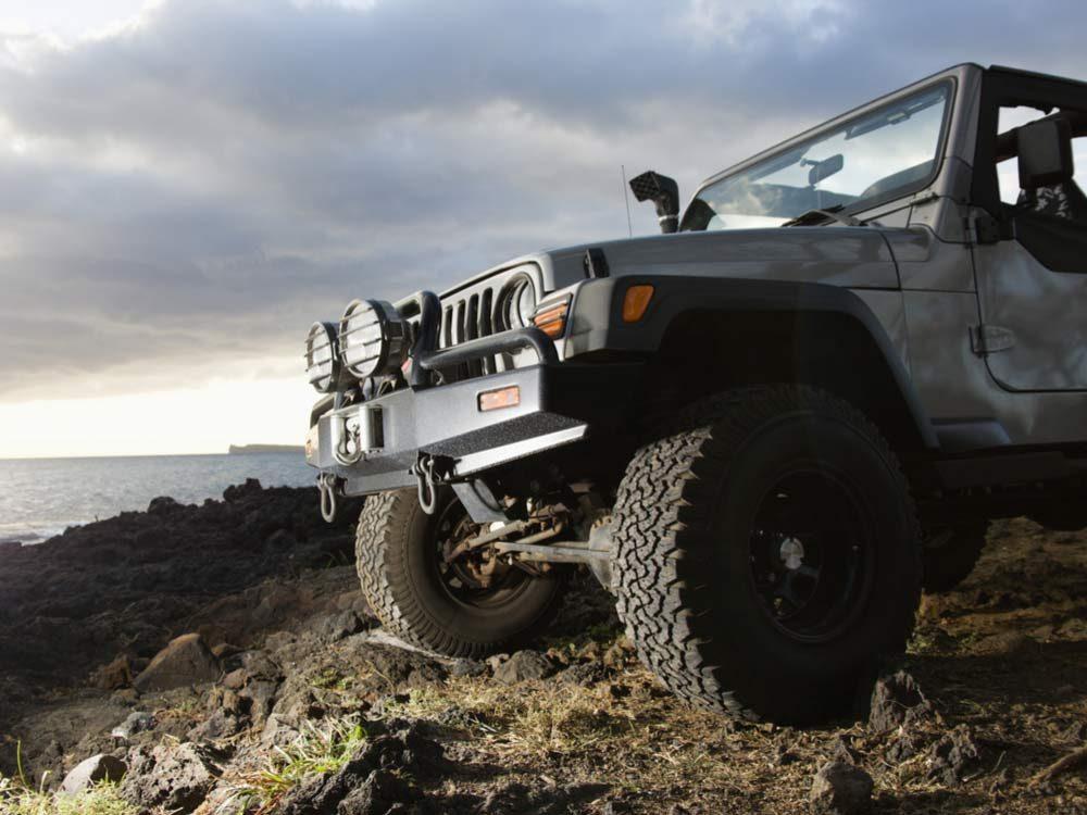 SUV on rocky beach