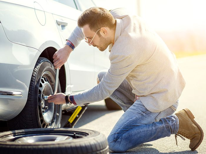 How to change a flat tire - man changing tire