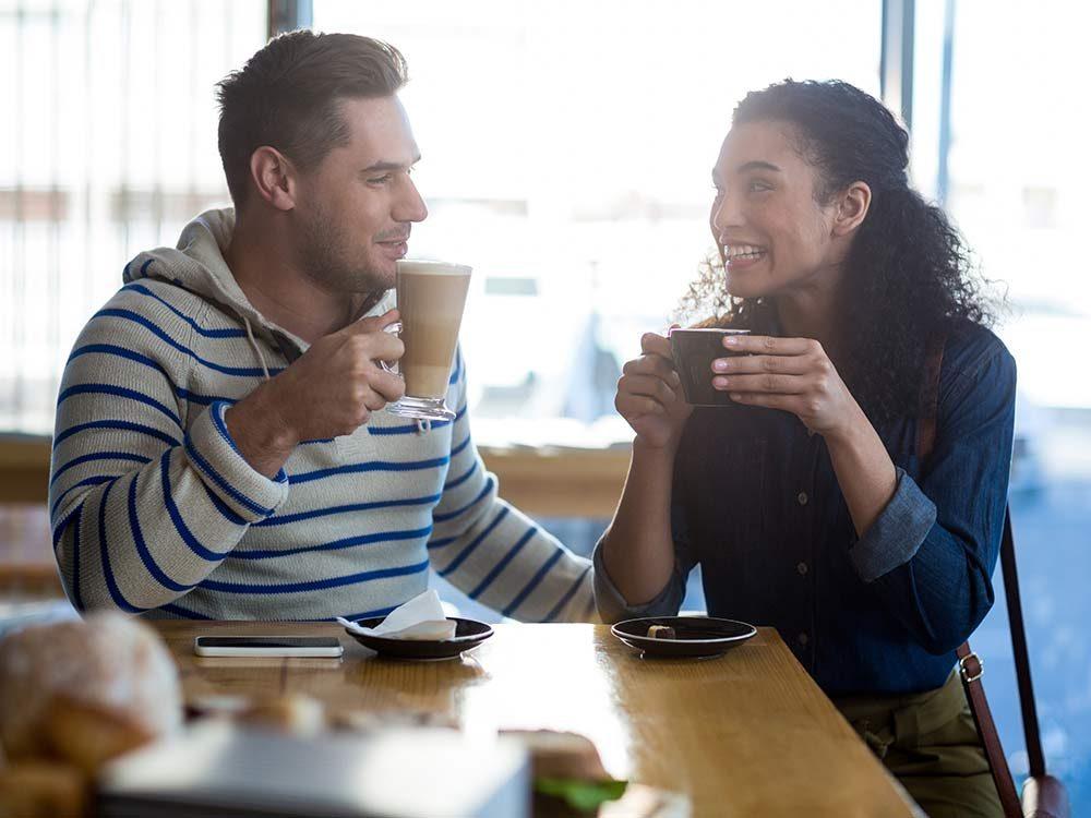 Man and woman talking at a cafe