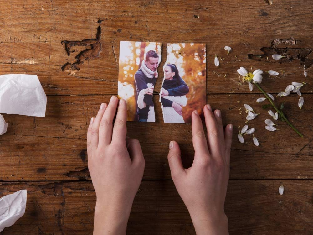 Torn picture of couple