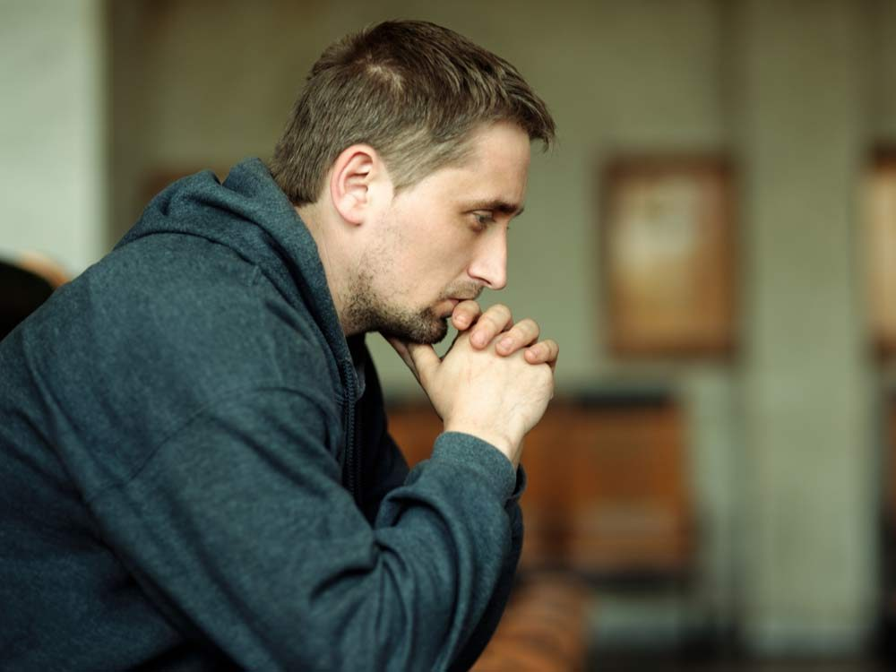Serious man lost in thought
