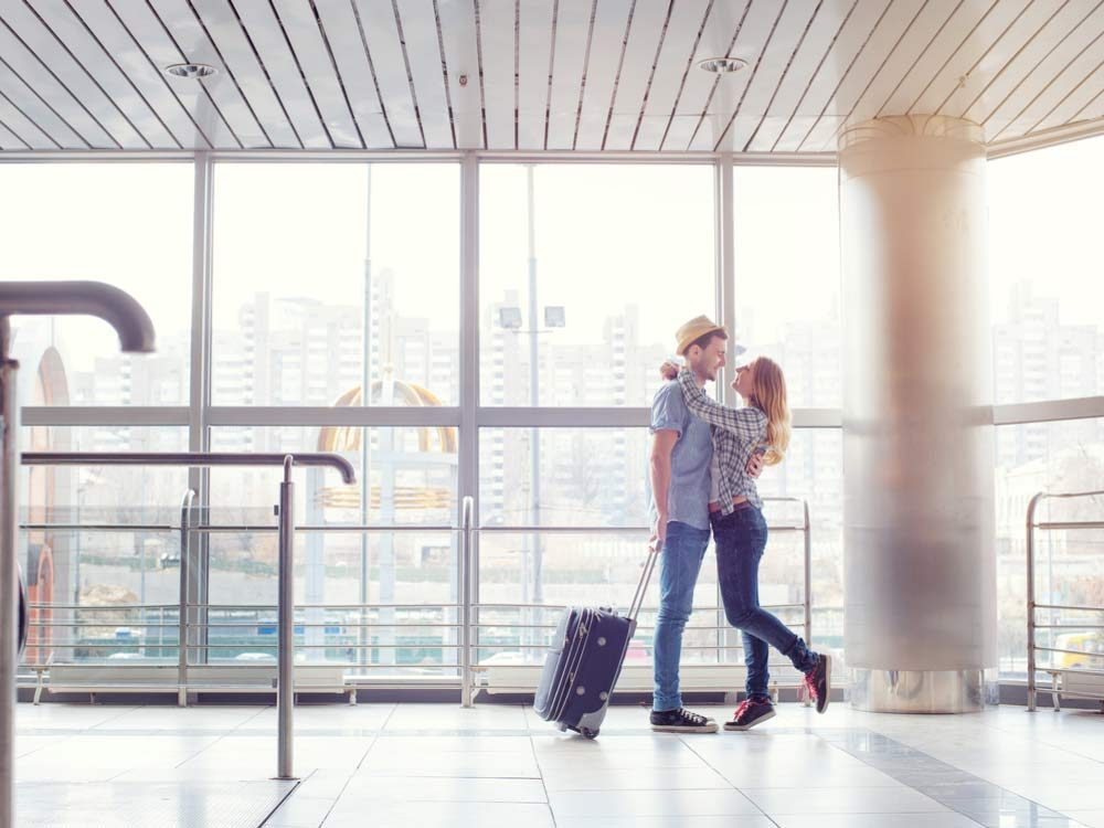 Couple showing PDA at airport