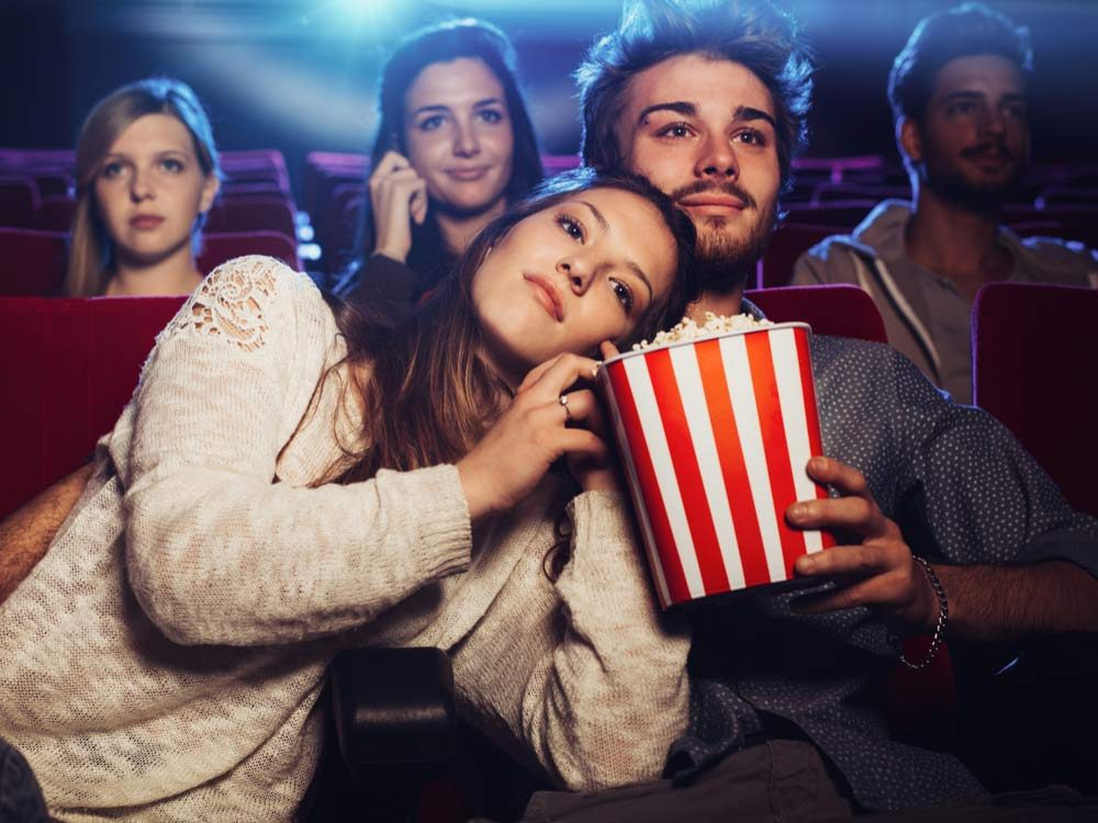Couple cuddling at movie