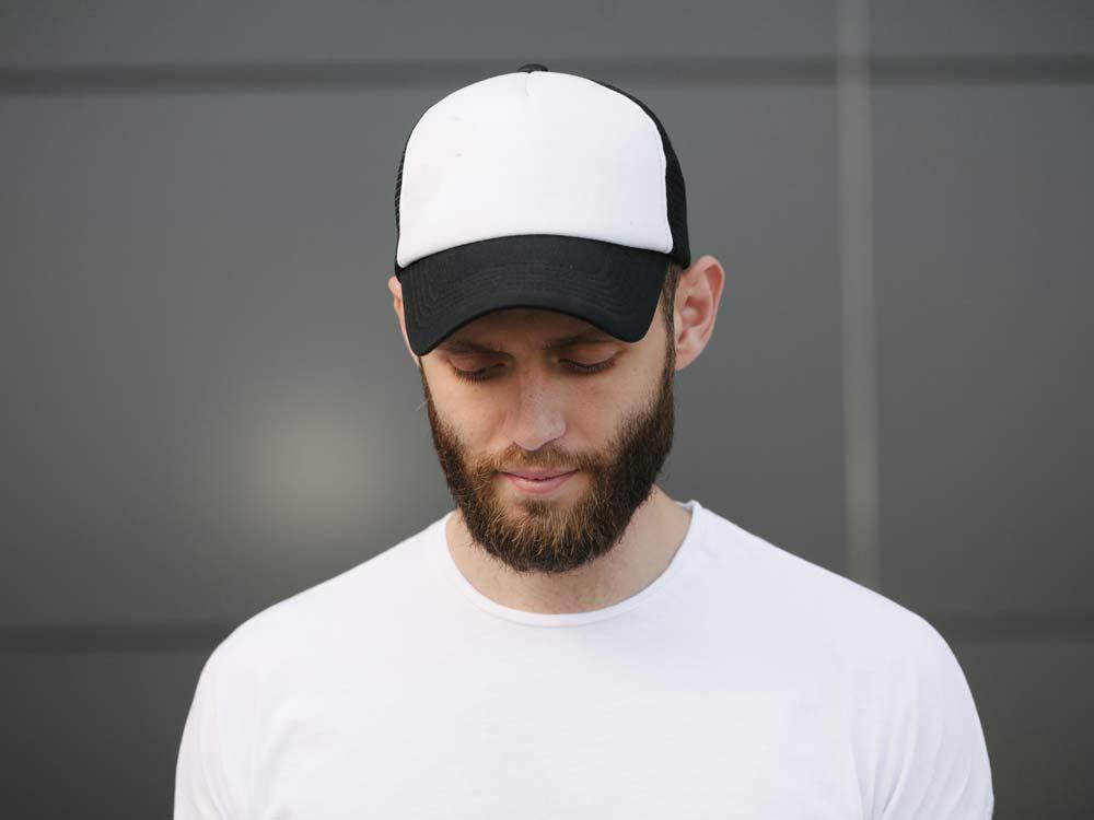 Bearded man wearing baseball cap