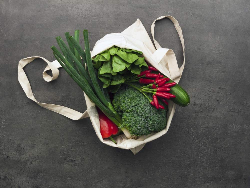 Reusable grocery bags with vegetables